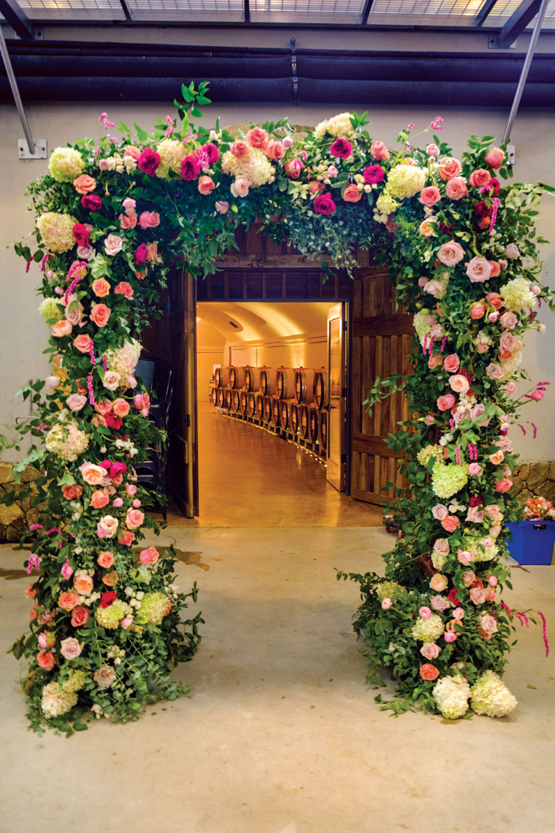 cf3a36b3aa A floral arch assembled on location for a wedding. Photo by Gaston Lacombe.