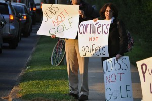 ACT member Ronit Dancis  in front of the Columbia Country Club on Monday
