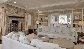From the new family room, the Collinses can see the kitchen and the backyard beyond.