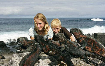Caroline and Conor and assorted creatures on the Galápagos Islands.