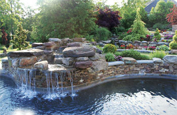 Water tumbles over boulders before entering the pool at the Bergmans' Potomac home, creating the look of a natural pond.