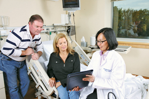 Dr. Bernadette Gochuico, right, consults with Nancy Groski and her husband, Jim. Photo by Stacy Zarin-Goldberg