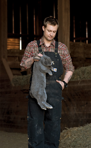 Voltaggio holds a silver fox rabbit at Whitmore Farm, which provides some of the meat for his restaurants. Photo by Erick Gibson