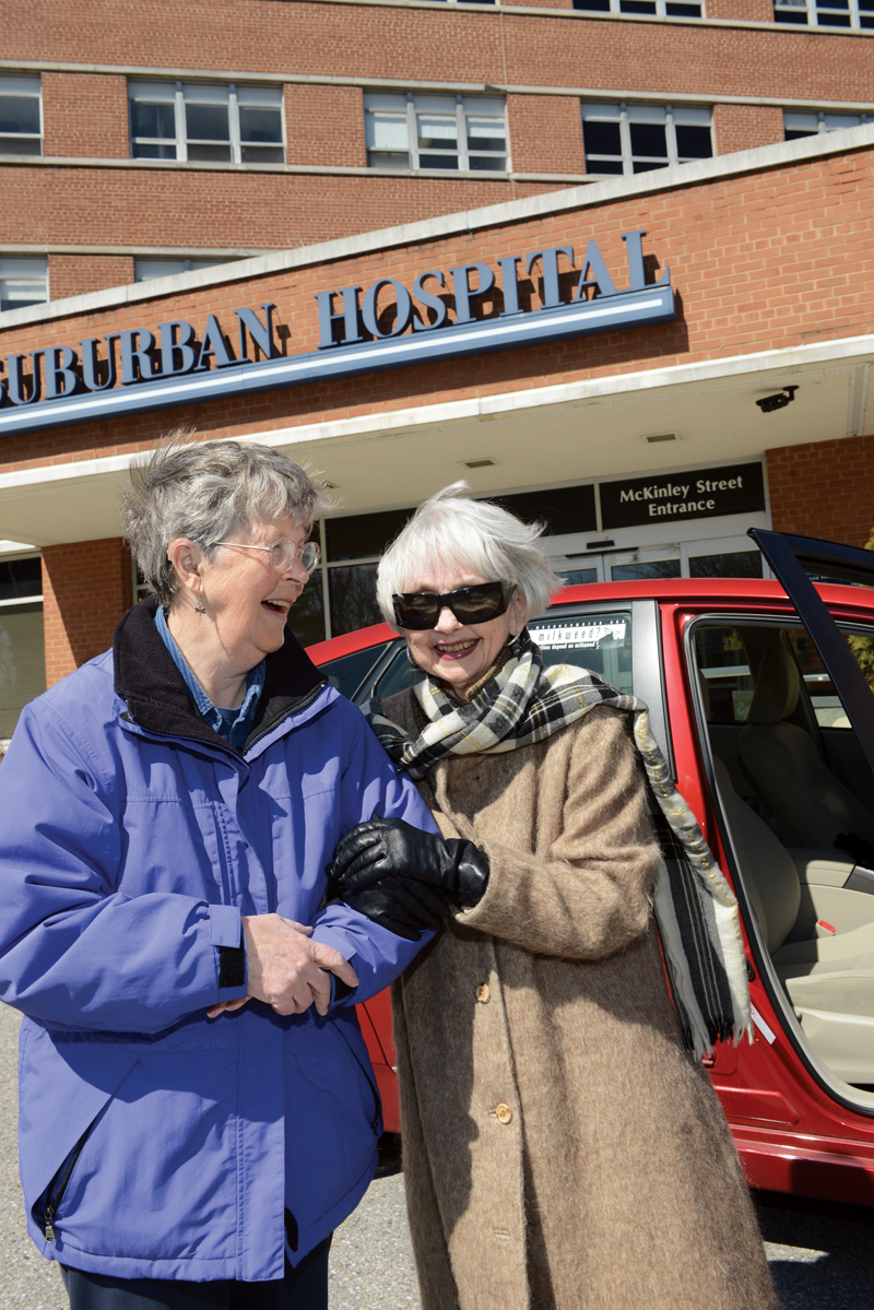 Pat Schleifer (right) relies on neighbor Marion Robertson and other Chevy Chase At Home volunteers to drive her to weekly therapy appointments at Bethesda's Suburban Hospital. Photo by Hilary Schwab