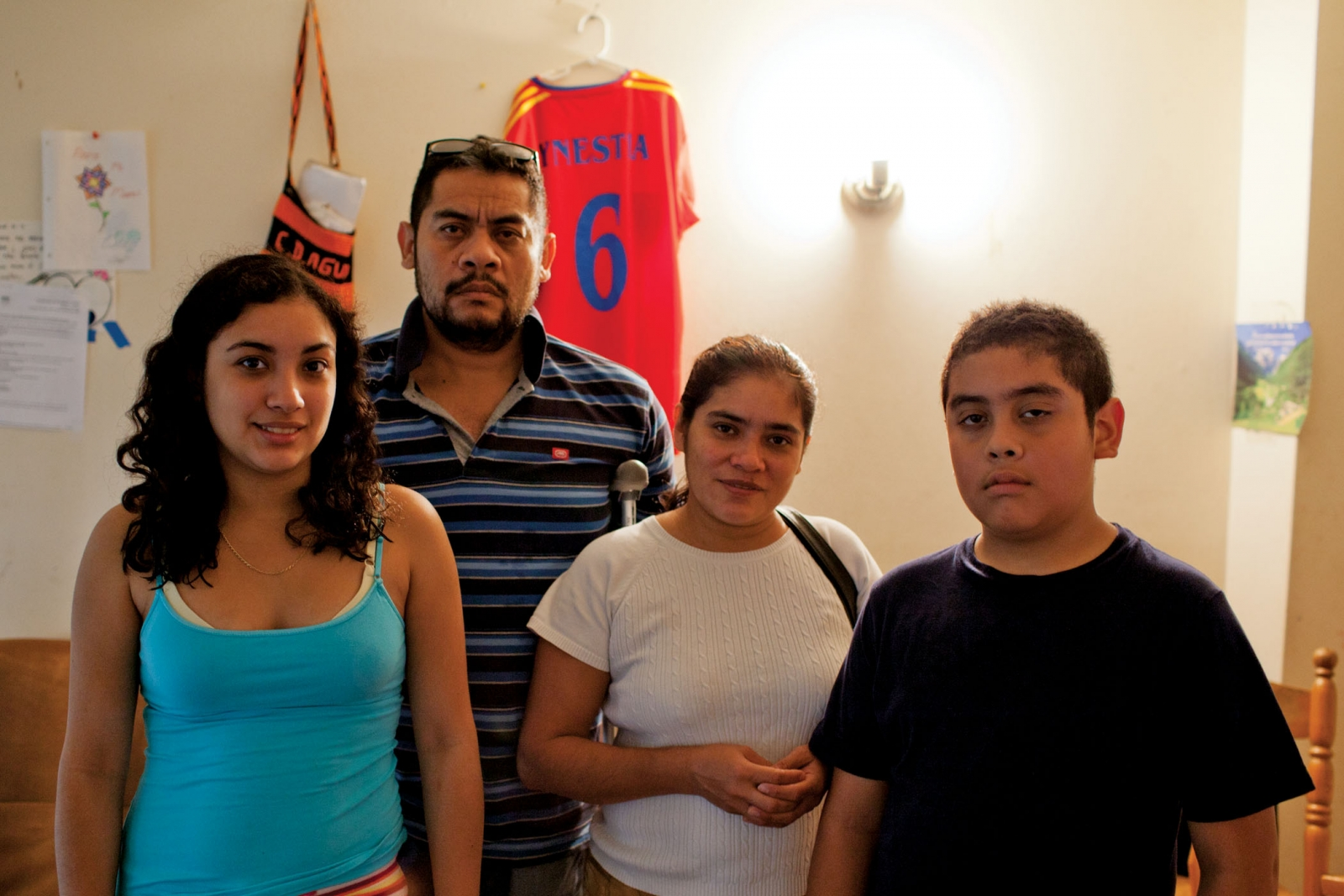 Henry Aleman, his wife, Ester Maria, and their two children, Sandra and Henry Jr., share a single bedroom in Takoma Park and use food stamps at Giant. Photo credit: Francis Tatem