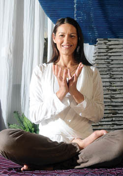 Kim Groark has created a soothing environment for her yoga practice at Sacred Space in Rockville.