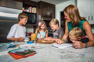 From left: Will, 14, Emma, 6, Ben, 12, and Ryan, 8, hang out in the kitchen with their mother, Melanie, a local singer. Photo by Darren Higgins