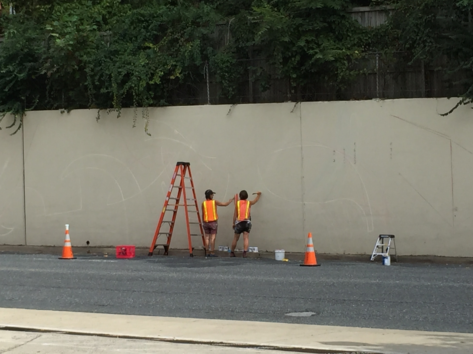 Jessie Unterhalter And Katey Truhn Start Painting A Mural On 400 Foot Long Concrete Wall Along Arlington Road Via Bethesda Urban Partnership
