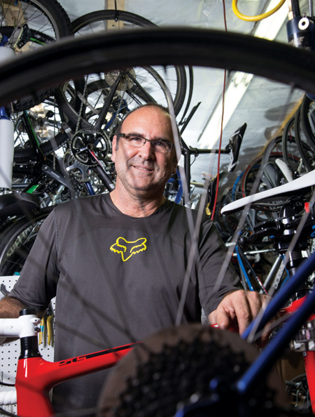 With race numbers lining the walls, bicycles hanging from the ceiling, and tools and gear stuffed in cubbies, Michael Gildenhorn's Bethesda garage is devoted to his cycling obsession.